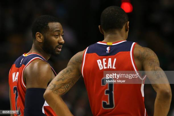 John Wall of the Washington Wizards and Bradley Beal talk together during the third quarter against the Boston Celtics at TD Garden on March 20 2017...