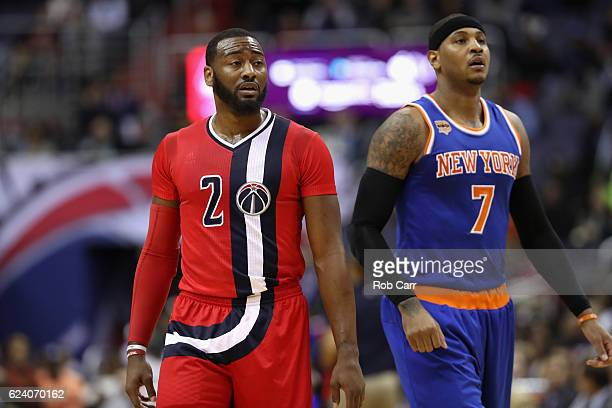 John Wall of the Washington Wizards and Carmelo Anthony of the New York Knicks look on during a free throw attempt at Verizon Center on November 17...