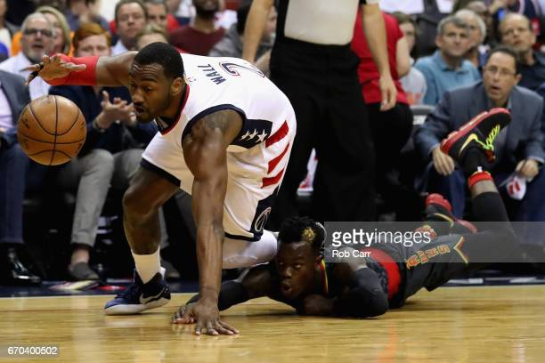 John Wall of the Washington Wizards and Dennis Schroder of the Atlanta Hawks go after the ball in the first half of Game Two of the Eastern...