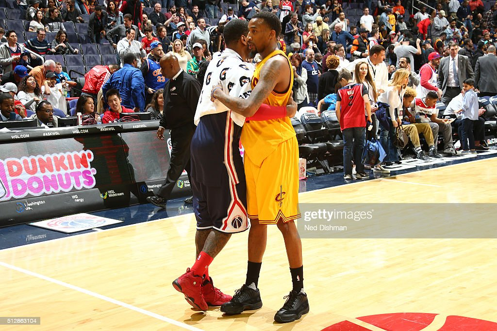 John Wall of the Washington Wizards and Jordan McRae of the Cleveland Cavaliers shake hands after the game on February 28 2016 at Verizon Center in...