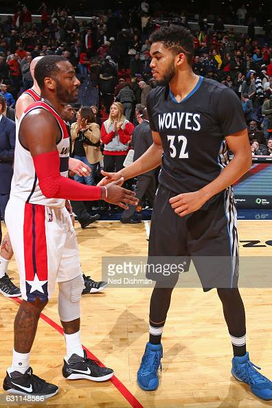 John Wall of the Washington Wizards and KarlAnthony Towns of the Minnesota Timberwolves shake hands after the game on January 6 2017 at Verizon...