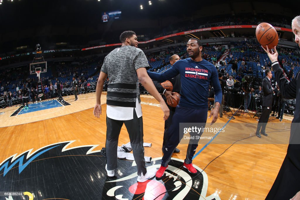 John Wall #2 of the Washington Wizards and Karl-Anthony Towns #32 of the Minnesota Timberwolves meet before a game on March 13, 2017 at Target Center in Minneapolis, Minnesota.