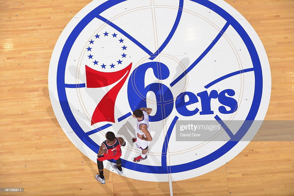 <a gi-track='captionPersonalityLinkClicked' href=/galleries/search?phrase=John+Wall&family=editorial&specificpeople=2265812 ng-click='$event.stopPropagation()'>John Wall</a> #2 of the Washington Wizards and <a gi-track='captionPersonalityLinkClicked' href=/galleries/search?phrase=Michael+Carter-Williams&family=editorial&specificpeople=7621167 ng-click='$event.stopPropagation()'>Michael Carter-Williams</a> #1 of the Philadelphia 76ers stand on the court against the Washington Wizards on November 6, 2013 in Philadelphia, Pennsylvania.
