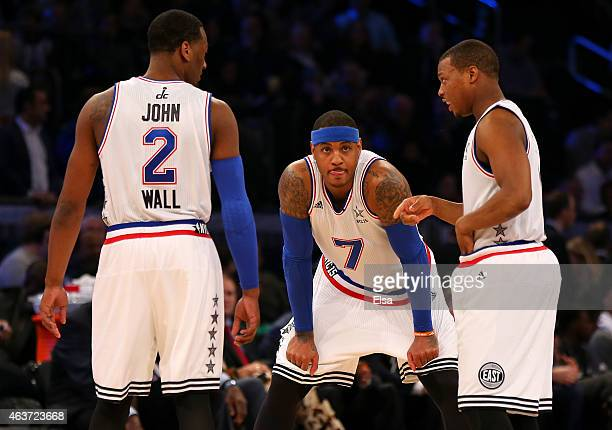 John Wall of the Washington Wizards and the Eastern Conference talks with Carmelo Anthony of the New York Knicks and the Eastern Conference Kyle...