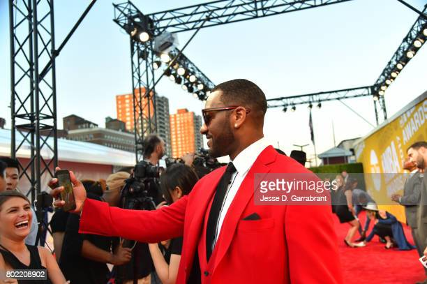 John Wall of the Washington Wizards arrives on the red carpet during the 2017 NBA Awards Show on June 26 2017 at Basketball City in New York City...