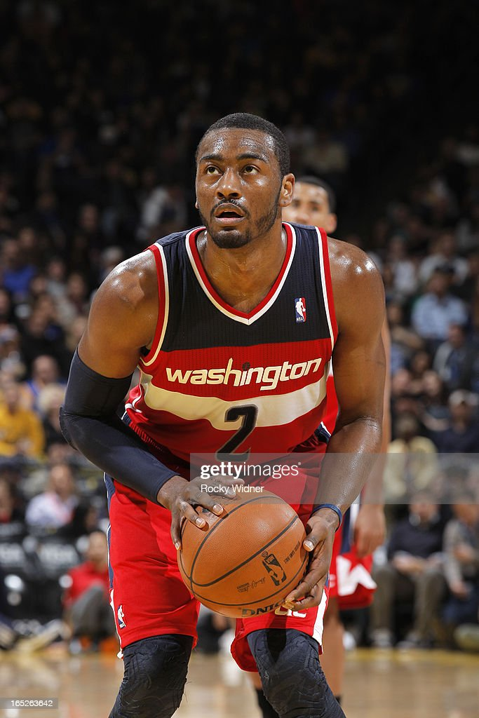 <a gi-track='captionPersonalityLinkClicked' href=/galleries/search?phrase=John+Wall&family=editorial&specificpeople=2265812 ng-click='$event.stopPropagation()'>John Wall</a> #2 of the Washington Wizards attempts a free throw against the Golden State Warriors on March 23, 2013 at Oracle Arena in Oakland, California.