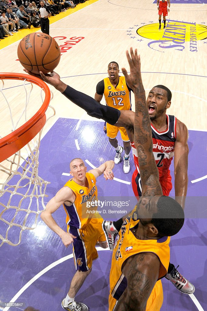 <a gi-track='captionPersonalityLinkClicked' href=/galleries/search?phrase=John+Wall&family=editorial&specificpeople=2265812 ng-click='$event.stopPropagation()'>John Wall</a> #2 of the Washington Wizards attempts a layup against Earl Clark #6 of the Los Angeles Lakers at Staples Center on March 22, 2013 in Los Angeles, California.