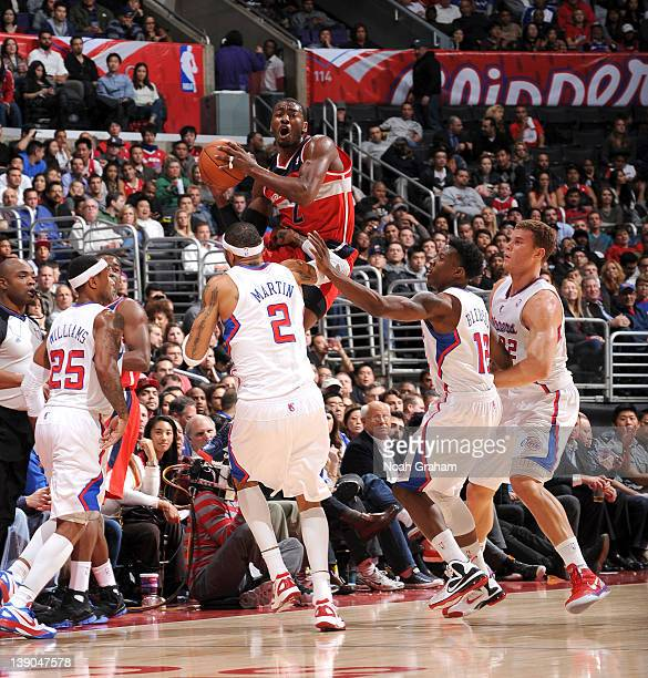John Wall of the Washington Wizards attempts a shot at midcourt against Mo Williams Kenyon Martin Eric Bledsoe and Blake Griffin of the Los Angeles...