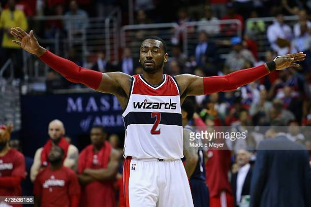 John Wall of the Washington Wizards attempts to calm the crowd during the second half against the Atlanta Hawks at Verizon Center on May 15 2015 in...