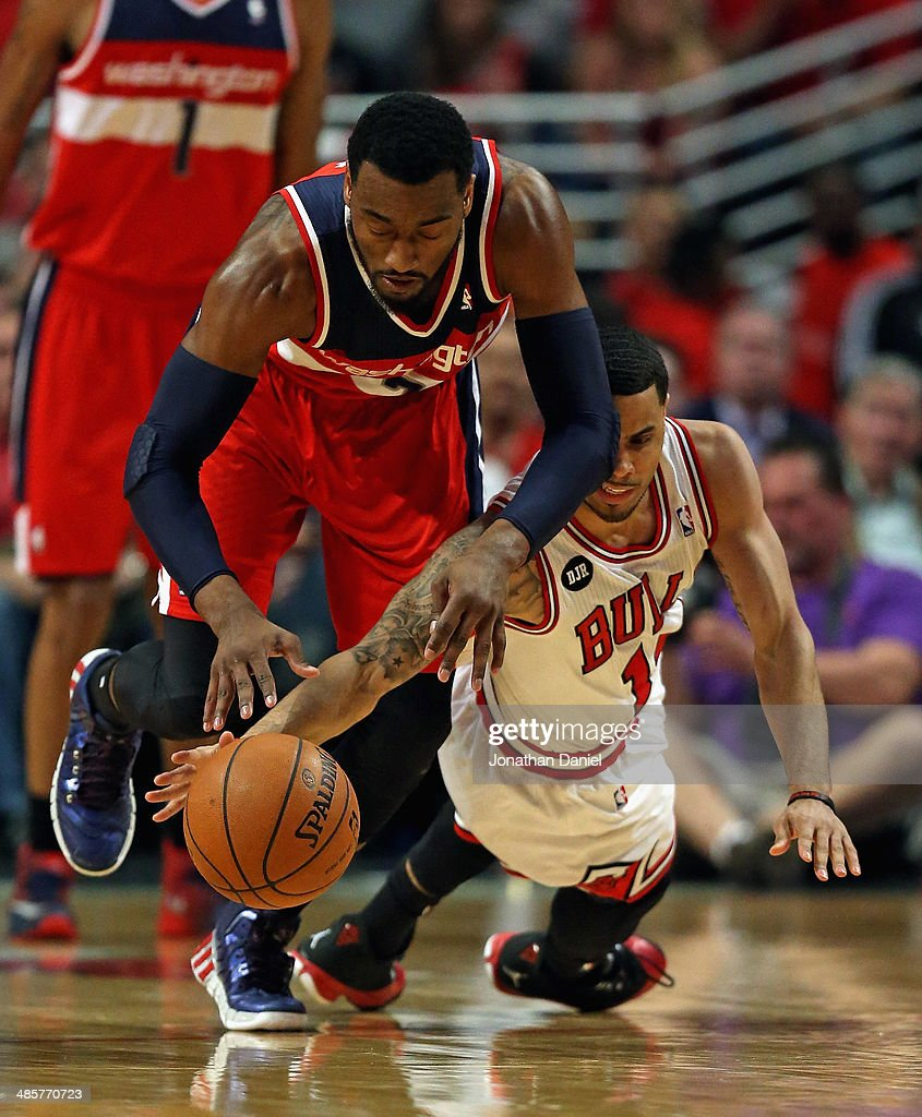 <a gi-track='captionPersonalityLinkClicked' href=/galleries/search?phrase=John+Wall&family=editorial&specificpeople=2265812 ng-click='$event.stopPropagation()'>John Wall</a> #2 of the Washington Wizards battles for the ball with <a gi-track='captionPersonalityLinkClicked' href=/galleries/search?phrase=D.J.+Augustin&family=editorial&specificpeople=3847521 ng-click='$event.stopPropagation()'>D.J. Augustin</a> #14 of the Chicago Bulls in Game One of the Eastern Conference Quarterfinals during the 2014 NBA Playoffs at the United Center on April 20, 2014 in Chicago, Illinois.