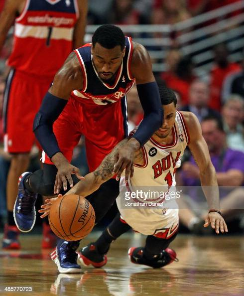 John Wall of the Washington Wizards battles for the ball with DJ Augustin of the Chicago Bulls in Game One of the Eastern Conference Quarterfinals...