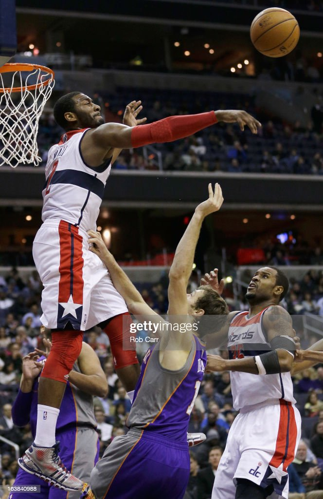 <a gi-track='captionPersonalityLinkClicked' href=/galleries/search?phrase=John+Wall&family=editorial&specificpeople=2265812 ng-click='$event.stopPropagation()'>John Wall</a> #2 of the Washington Wizards blocks a shot by <a gi-track='captionPersonalityLinkClicked' href=/galleries/search?phrase=Goran+Dragic&family=editorial&specificpeople=4452965 ng-click='$event.stopPropagation()'>Goran Dragic</a> #1 of the Phoenix Suns as teammate <a gi-track='captionPersonalityLinkClicked' href=/galleries/search?phrase=Trevor+Booker&family=editorial&specificpeople=4123563 ng-click='$event.stopPropagation()'>Trevor Booker</a> #35 looks on during the second half at Verizon Center on March 16, 2013 in Washington, DC.