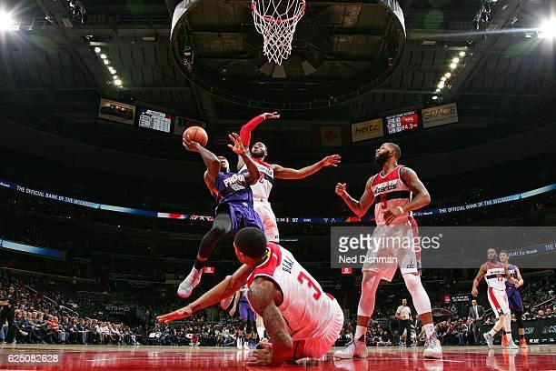 John Wall of the Washington Wizards blocks the shot of Eric Bledsoe of the Phoenix Suns on November 21 2016 at Verizon Center in Washington DC NOTE...