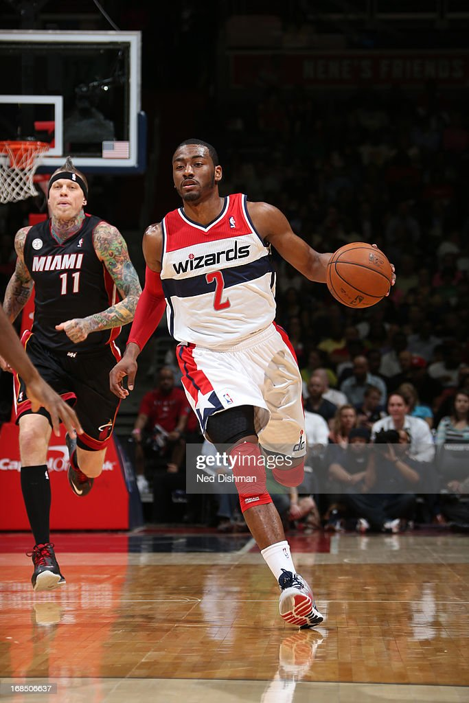 <a gi-track='captionPersonalityLinkClicked' href=/galleries/search?phrase=John+Wall&family=editorial&specificpeople=2265812 ng-click='$event.stopPropagation()'>John Wall</a> #2 of the Washington Wizards brings the ball up court against the Miami Heat at the Verizon Center on April 10, 2013 in Washington, DC.