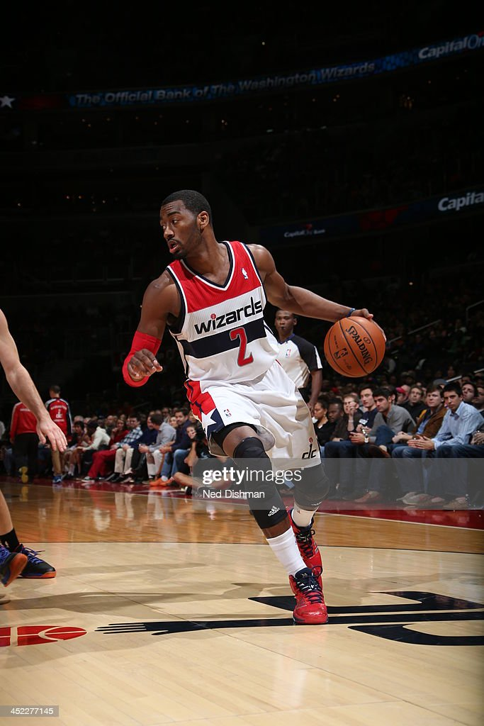 <a gi-track='captionPersonalityLinkClicked' href=/galleries/search?phrase=John+Wall&family=editorial&specificpeople=2265812 ng-click='$event.stopPropagation()'>John Wall</a> #2 of the Washington Wizards brings the ball up the court while looking to pass against the New York Knicks during the game at the Verizon Center on November 23, 2013 in Washington, DC.