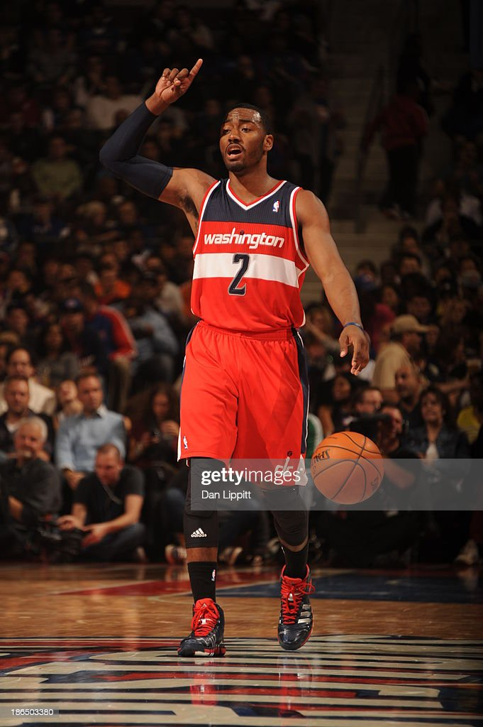<a gi-track='captionPersonalityLinkClicked' href=/galleries/search?phrase=John+Wall&family=editorial&specificpeople=2265812 ng-click='$event.stopPropagation()'>John Wall</a> #2 of the Washington Wizards brings the ball up the floor against the Detroit Pistons during the game on October 30, 2013 at The Palace of Auburn Hills in Auburn Hills, Michigan.