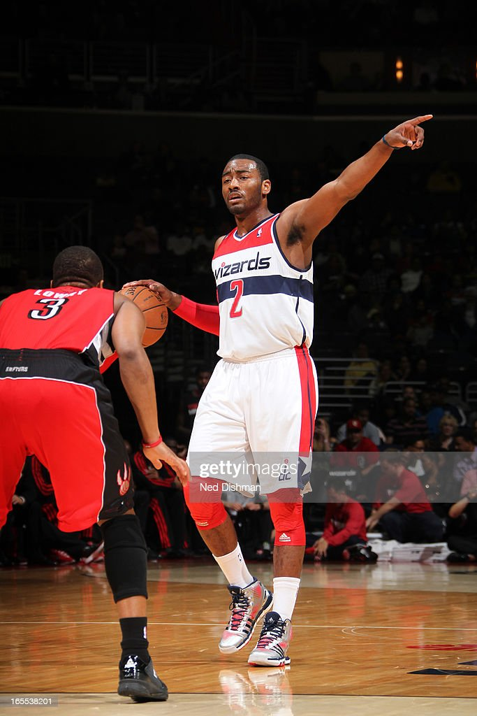 John Wall #2 of the Washington Wizards calls a play during the game against the Toronto Raptors at the Verizon Center on March 31, 2013 in Washington, DC.