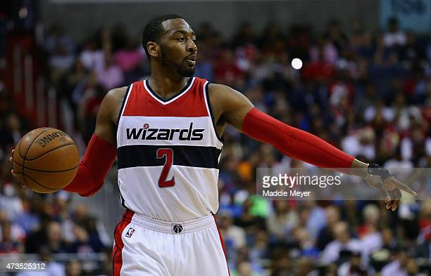 John Wall of the Washington Wizards calls a play during the second quarter against the Atlanta Hawks at Verizon Center on May 15 2015 in Washington DC