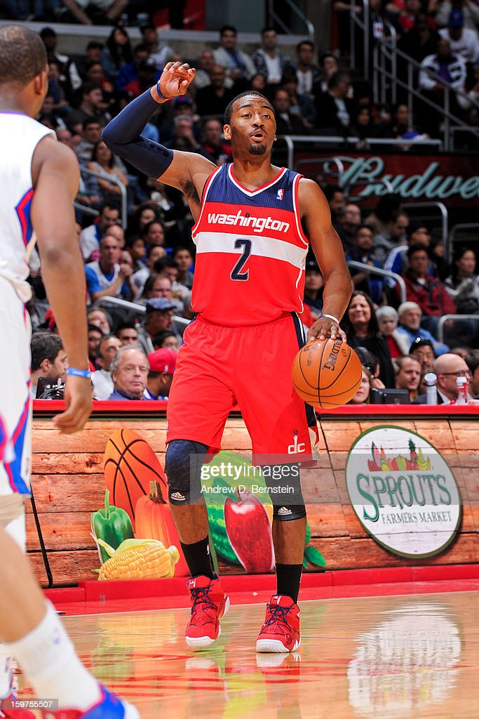 John Wall #2 of the Washington Wizards calls a play out to his teammates against the Los Angeles Clippers at Staples Center on January 19, 2013 in Los Angeles, California.