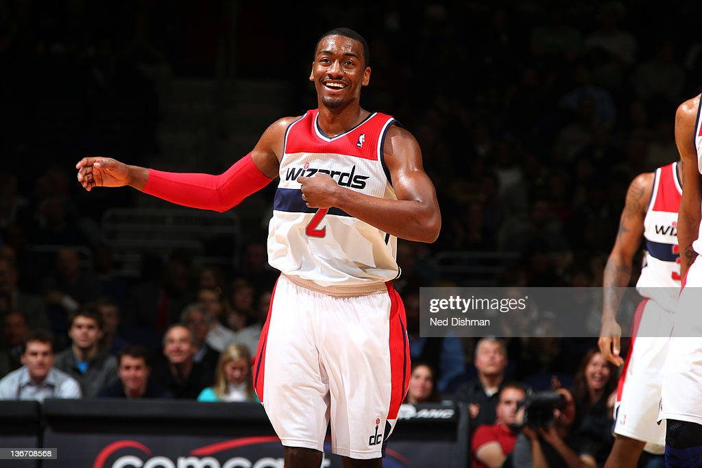 <a gi-track='captionPersonalityLinkClicked' href=/galleries/search?phrase=John+Wall&family=editorial&specificpeople=2265812 ng-click='$event.stopPropagation()'>John Wall</a> #2 of the Washington Wizards celebrates a basket against the Toronto Raptors during the game at the Verizon Center on January 10, 2012 in Washington, DC.