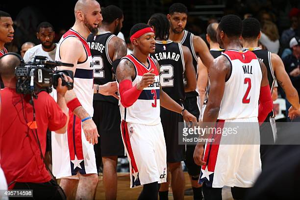 John Wall of the Washington Wizards celebrates a game winner by Bradley Beal of the Washington Wizards against the San Antonio Spurs on November 4...