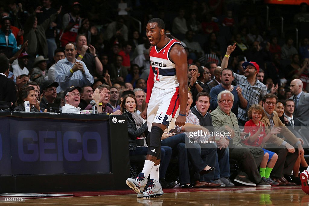 <a gi-track='captionPersonalityLinkClicked' href=/galleries/search?phrase=John+Wall&family=editorial&specificpeople=2265812 ng-click='$event.stopPropagation()'>John Wall</a> #2 of the Washington Wizards celebrates a made basket against the Philadelphia 76ers during the pre-season game at the Verizon Center on November 1, 2013 in Washington, DC.