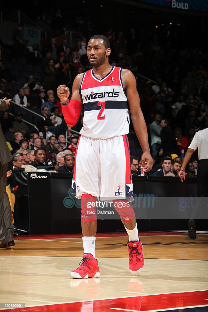 <a gi-track='captionPersonalityLinkClicked' href=/galleries/search?phrase=John+Wall&family=editorial&specificpeople=2265812 ng-click='$event.stopPropagation()'>John Wall</a> #2 of the Washington Wizards celebrates a made shot against the Denver Nuggets during the game at the Verizon Center on February 22, 2013 in Washington, DC.