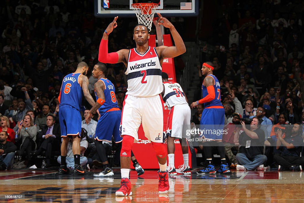 <a gi-track='captionPersonalityLinkClicked' href=/galleries/search?phrase=John+Wall&family=editorial&specificpeople=2265812 ng-click='$event.stopPropagation()'>John Wall</a> #2 of the Washington Wizards celebrates a three point shot against the New York Knicks during the game at the Verizon Center on February 6, 2013 in Washington, DC.