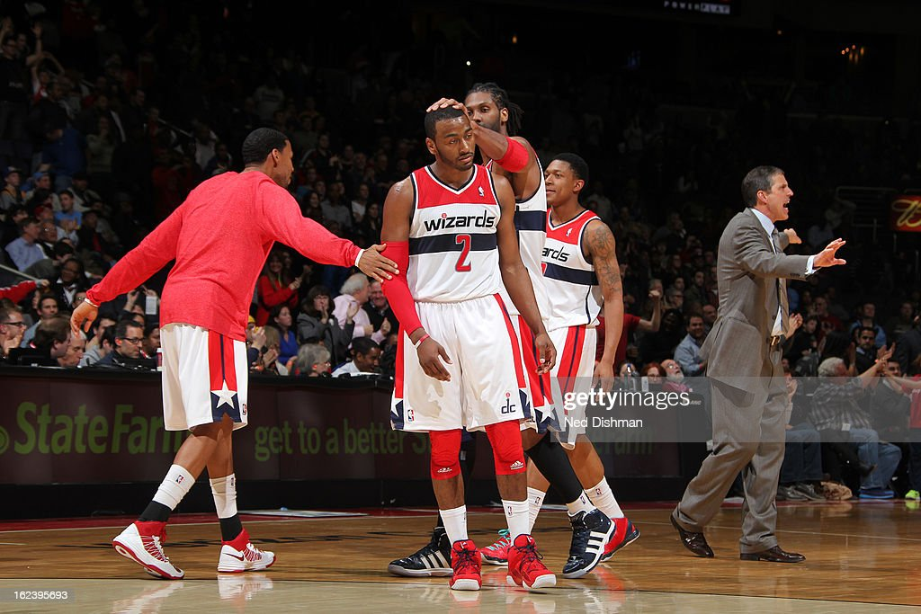 <a gi-track='captionPersonalityLinkClicked' href=/galleries/search?phrase=John+Wall&family=editorial&specificpeople=2265812 ng-click='$event.stopPropagation()'>John Wall</a> #2 of the Washington Wizards celebrates after he made a shot against the Denver Nuggets during the game at the Verizon Center on February 22, 2013 in Washington, DC.