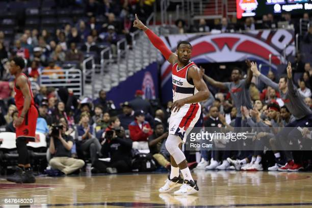 John Wall of the Washington Wizards celebrates after making a basket against the Toronto Raptors in the first half at Verizon Center on March 3 2017...