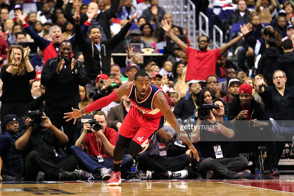 <a gi-track='captionPersonalityLinkClicked' href=/galleries/search?phrase=John+Wall&family=editorial&specificpeople=2265812 ng-click='$event.stopPropagation()'>John Wall</a> #2 of the Washington Wizards celebrates after scoring a basket during the first half against the Cleveland Cavaliers at Verizon Center on November 21, 2014 in Washington, DC.