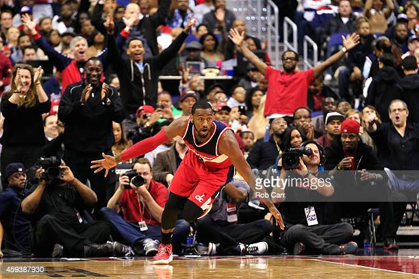 John Wall of the Washington Wizards celebrates after scoring a basket during the first half against the Cleveland Cavaliers at Verizon Center on...