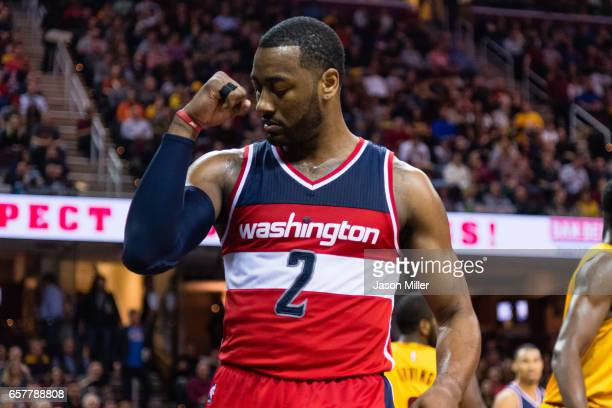 John Wall of the Washington Wizards celebrates after scoring during the first half against the Cleveland Cavaliers at Quicken Loans Arena on March 25...