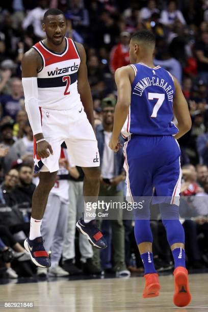 John Wall of the Washington Wizards celebrates after scoring in front of Timothe LuwawuCabarrot of the Philadelphia 76ers in the second half at...