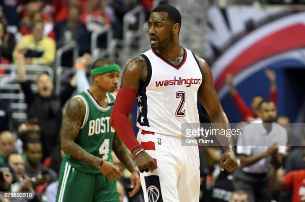 John Wall of the Washington Wizards celebrates after scoring in the third quarter against the Boston Celtics in Game Three of the Eastern Conference...