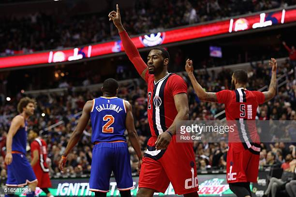John Wall of the Washington Wizards celebrates after the Wizards scored in the closing mintues of their 9989 win over the New York Knicks at Verizon...