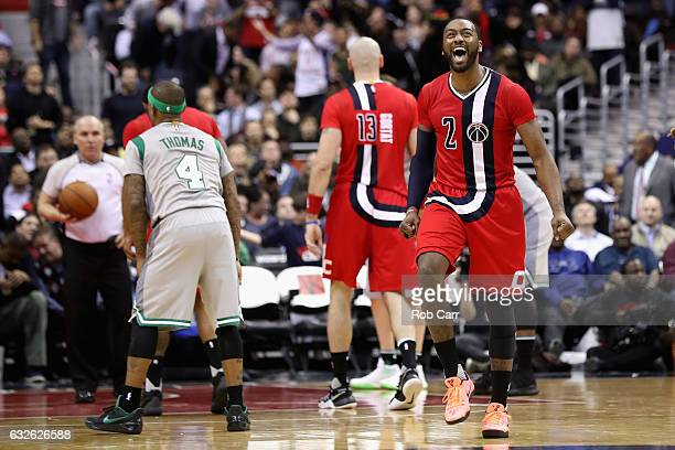 John Wall of the Washington Wizards celebrates during the closing mintues of the Wizards 123108 win over the Boston Celtics at Verizon Center on...