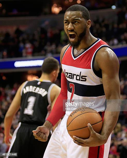 John Wall of the Washington Wizards celebrates in front of Kyle Anderson of the San Antonio Spurs after the Wizards defeated the Spurs 10193 at...