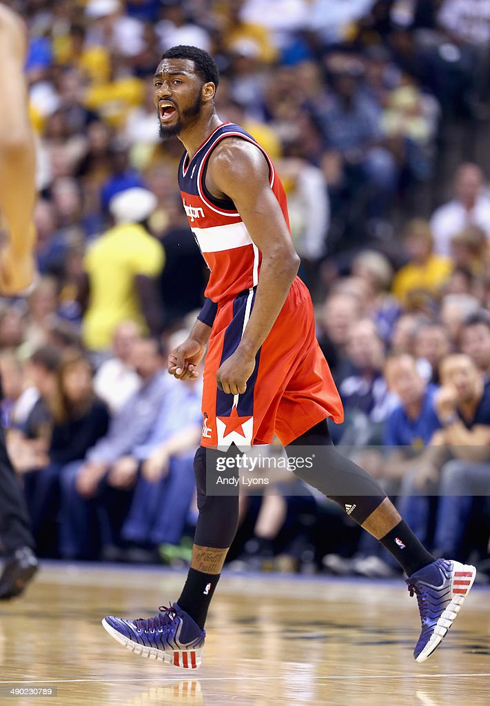 <a gi-track='captionPersonalityLinkClicked' href=/galleries/search?phrase=John+Wall&family=editorial&specificpeople=2265812 ng-click='$event.stopPropagation()'>John Wall</a> #2 of the Washington Wizards celebrates in the 102-79 win over the Indiana Pacers in Game 5 of the Eastern Conference Semifinals during the 2014 NBA Playoffs at Bankers Life Fieldhouse on May 13, 2014 in Indianapolis, Indiana.