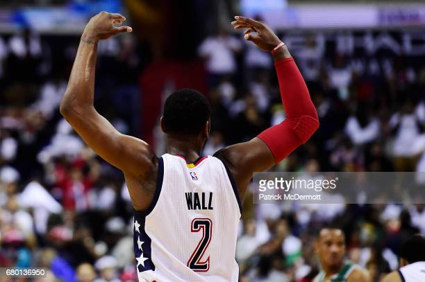 John Wall of the Washington Wizards celebrates in the third quarter against the Boston Celtics in Game Four of the Eastern Conference Semifinals at...