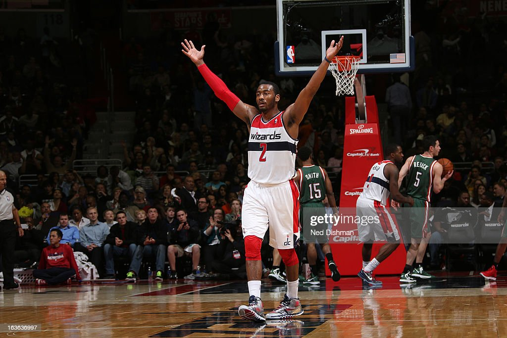 <a gi-track='captionPersonalityLinkClicked' href=/galleries/search?phrase=John+Wall&family=editorial&specificpeople=2265812 ng-click='$event.stopPropagation()'>John Wall</a> #2 of the Washington Wizards celebrates the win against the Milwaukee Bucks during the game at the Verizon Center on March 13, 2013 in Washington, DC.