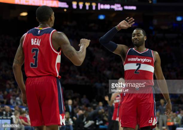 John Wall of the Washington Wizards celebrates with Bradley Beal in the second quarter at the Wells Fargo Center on February 24 2017 in Philadelphia...