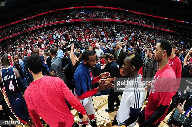 John Wall of the Washington Wizards congratulates Dennis Schroder of the Atlanta Hawks after Game Six of the Eastern Conference Semifinals during the...