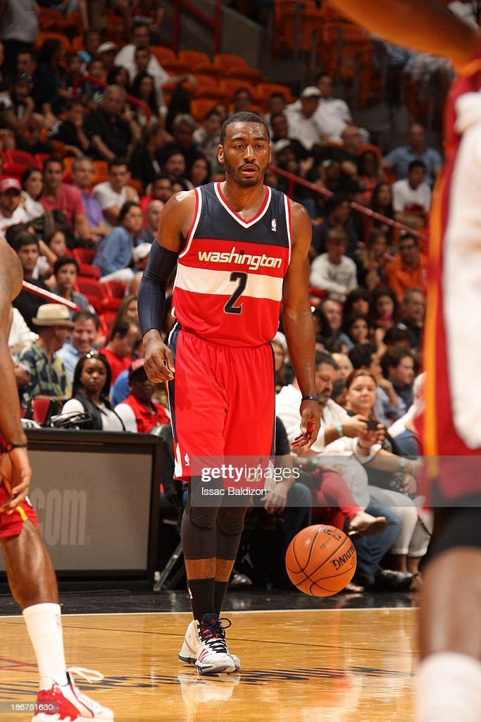 <a gi-track='captionPersonalityLinkClicked' href=/galleries/search?phrase=John+Wall&family=editorial&specificpeople=2265812 ng-click='$event.stopPropagation()'>John Wall</a> #2 of the Washington Wizards controls the ball against the Miami Heat on November 3, 2013 at American Airlines Arena in Miami, Florida.
