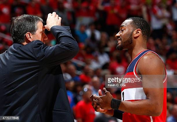 John Wall of the Washington Wizards converses with Randy Wittman during Game One of the Eastern Conference Semifinals of the 2015 NBA Playoffs...