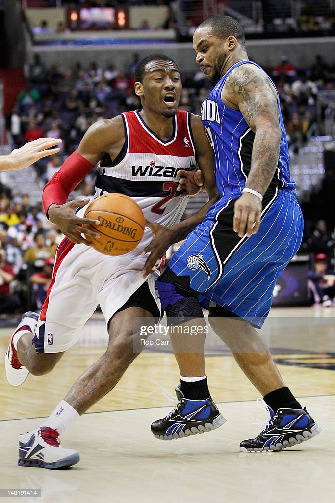 <a gi-track='captionPersonalityLinkClicked' href=/galleries/search?phrase=John+Wall&family=editorial&specificpeople=2265812 ng-click='$event.stopPropagation()'>John Wall</a> #2 of the Washington Wizards draws a foul while being guarded by <a gi-track='captionPersonalityLinkClicked' href=/galleries/search?phrase=Jameer+Nelson&family=editorial&specificpeople=202057 ng-click='$event.stopPropagation()'>Jameer Nelson</a> #14 of the Orlando Magic during the second half at the Verizon Center on February 29, 2012 in Washington, DC.