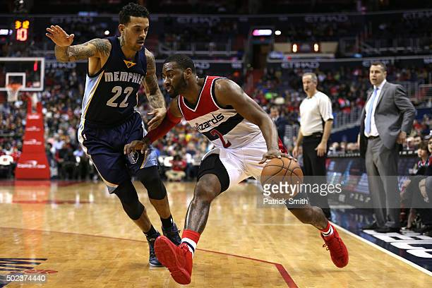 John Wall of the Washington Wizards dribbles past Matt Barnes of the Memphis Grizzlies in the second half at Verizon Center on December 23 2015 in...