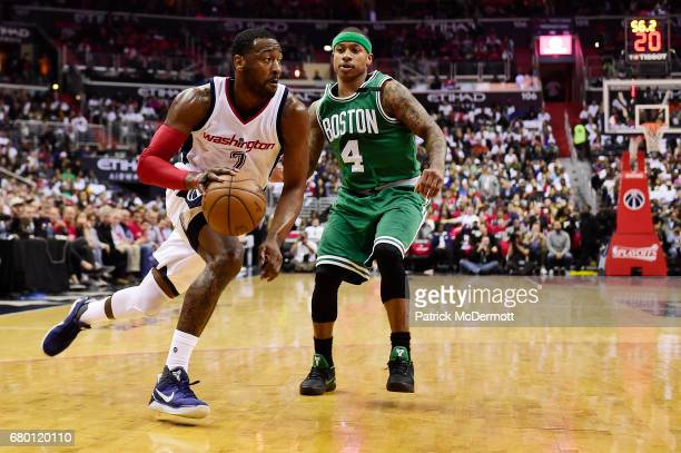 John Wall of the Washington Wizards dribbles the ball against Isaiah Thomas of the Boston Celtics in the second quarter in Game Four of the Eastern...