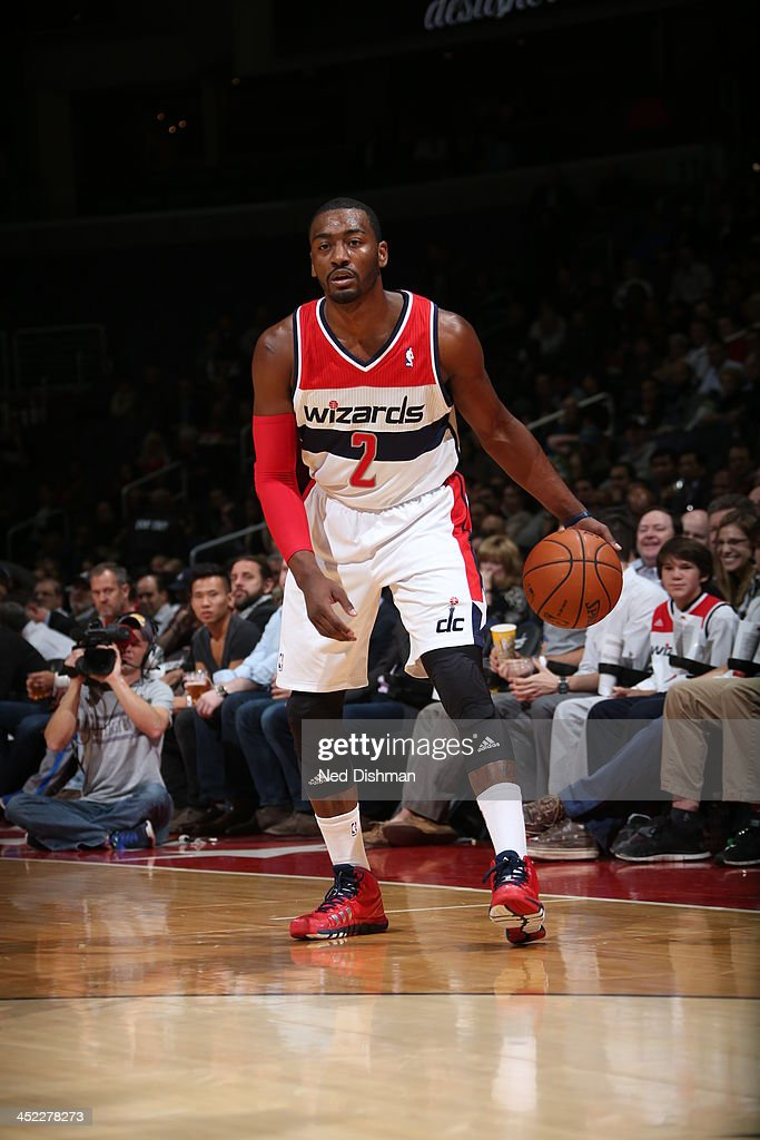<a gi-track='captionPersonalityLinkClicked' href=/galleries/search?phrase=John+Wall&family=editorial&specificpeople=2265812 ng-click='$event.stopPropagation()'>John Wall</a> #2 of the Washington Wizards dribbles the ball against the Minnesota Timberwolves during the game at the Verizon Center on November 19, 2013 in Washington, DC.