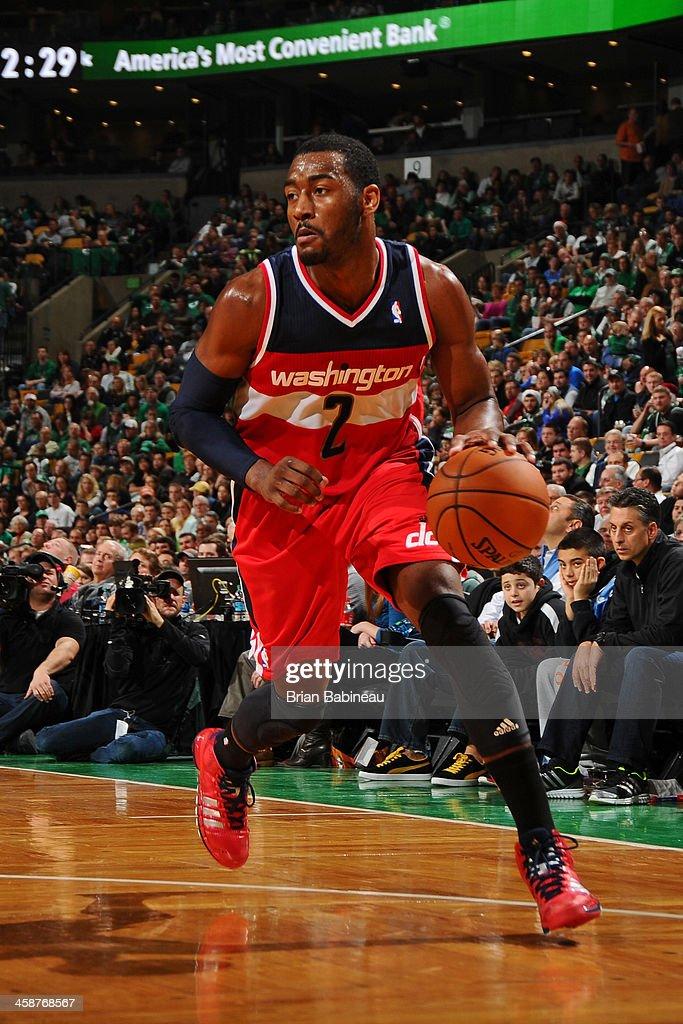 John Wall #2 of the Washington Wizards dribbles the ball against the Boston Celtics on December 21, 2013 at the TD Garden in Boston, Massachusetts.